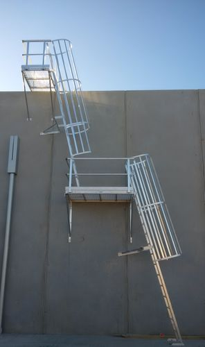 Angled Cage Ladder with change of direction Platform